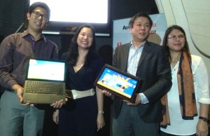 Lenovo PH chief Mike Ngan (2nd from right) is flanked by executives from Lenovo and Microsoft during the launch of Thinkpad Yoga