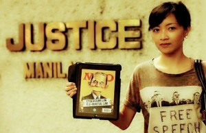FIle photo shows an activist displaying her disapproval of the Cybercrime Law during a rally in front of the Supreme Court and the Department of Justice