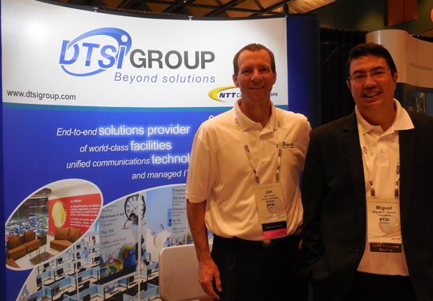 Photo shows  Jim Arnot, DTSI USA senior account manager (left), and Miguel C. Garcia, DTSI Group president and CEO, during the 2014 International Outsourcing World Summit (OWS) held in Florida, USA