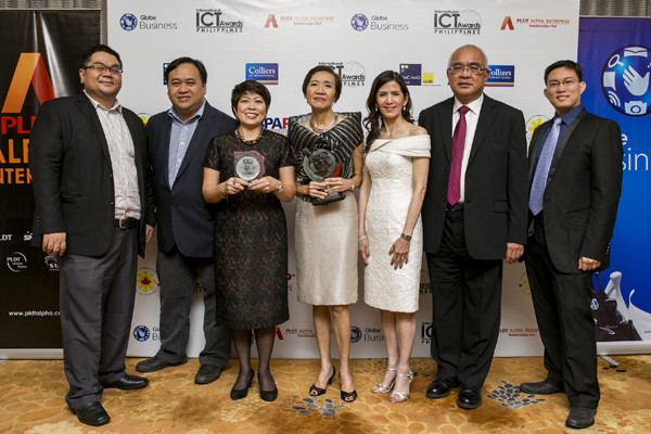 Pointwest president Beng Coronel (middle) receives the award in behalf of the company