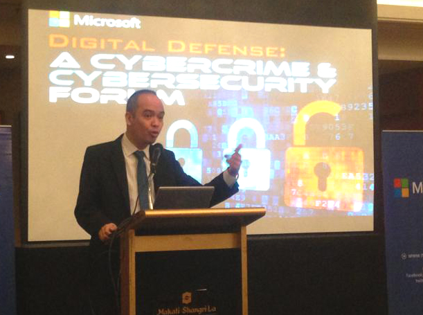 Joey Narciso, Special Investigator III of the NBI's cybercrime division, speaks during the cybercrime forum in Makati City