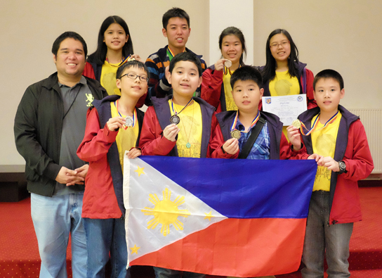 Filipino students show their medals at the 17th Clock Tower School International Mathematics Contest awarding ceremony in Romania. (Front row, from left to right) Eion Nikolai Chua, Stefan Marcus Ong, William Joshua King and Dion Stephan Ong, and (back row from left to right) team leader Justin Josef Villano, Jinger Chong, Gen Mark Tanno, Tiffany Mae Ong and Alyana Zoie Chua. (Photo by MTG)