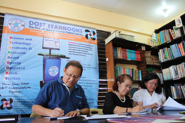 Photo shows (from left) Marikina representative Marcelino ?Marcy? Teodoro, DOST-NCR director Teresita Fortuna, and Malanday National High School principal Lagrimas B. Garcia signing the MOU