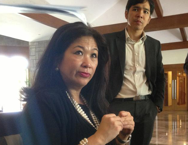 IBM Philippines chief Mariels Almeda Winhoffer (foreground) with communications manager Owen Cammayo during the launch