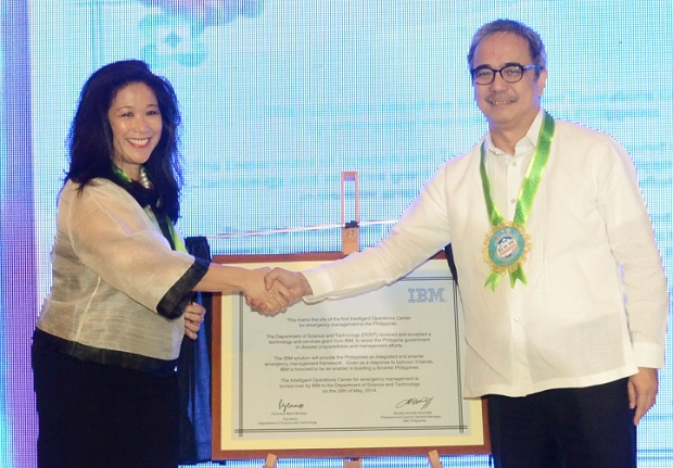 IBM Philippines chief Mariels Almeda Winhoffer  (left)  turns over the IOC to DOST sec. Mario Montejo at the PICC on Thursday