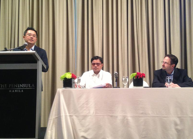 DOJ assistant secretary Geronimo Sy (standing) speaks at the podium during public consultation. Beside Sy is Alberto Salvador Jr. of DOST-ICT Office (center) and Tim Rains of Microsoft Trustworthy Computing Group