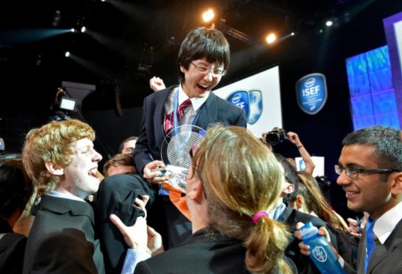 Nathan Han is celebrated by his fellow finalists for his first place win at the Intel International Science and Engineering Fair, the world?s largest high school science research competition. More than 1,700 high schoolers from 70 countries, regions and territories competed for more than $5 million in awards this week. Photo credit: Intel/Chris Ayers