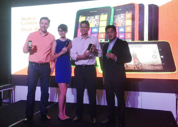 Karel Holub, general manager of Microsoft Mobile Devices Sales in the Philippines (extreme left) with executives from Air Asia, Grab Taxi, and Globe Gcash