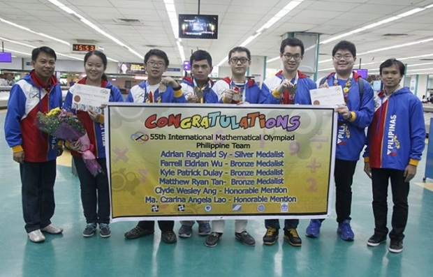 The Philippine team to the 55th IMO poses for a photo as they arrive from Cape Town, South Africa where they posted the best performance of the country in the hardest mathematics contest in world. The team brought home a silver medal, three bronze medals, and two honorable mentions ? the most number of medals in the country's history