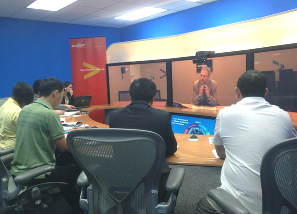 Accenture chief technology officer Paul Daugherty being interviewed by reporters via telepresence