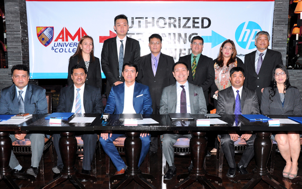 AMA vice chairman Amable C. Aguiluz IX and HP Philippines chief Ryan Guadalquiver pose with company executives during the signing of the partnership