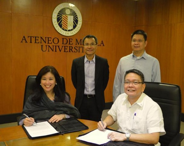 Signing the agreement are (seated, left) IBM Philippines chief Mariels Almeda-Winhoffer and Ateneo de Manila University president Fr. Jett Villarin. Witnessing the signing are (standing, left) IBM Philippines R&D executive Jay Sabido and Ateneo vice president for Loyola schools John Paul Vergara. Photo credit: www.ateneo.edu