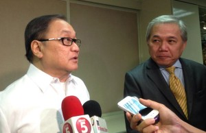 In this file photo, PLDT big boss Manny V. Pangilinan is seen being interviewed by the media with top lieutenant Ray Espinosa beside him