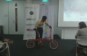 One of the participants demonstrate a folding bike during the competition
