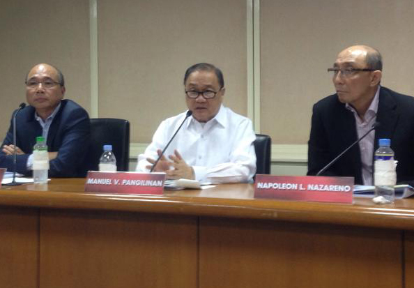 PLDT big boss Manny V. Pangilinan answers questions from the media during the announcement of the partnership on Thursday in Makati City. He is flanked by Smart chief wireless advisor Orlando Vea and PLDT president Napoleon Nazareno