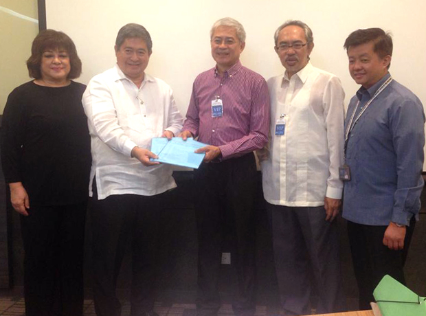 PRSP officers led by musician John Lesaca (center) sumbits their accreditation paper to IPO Philippines chief Ricardo Blancaflor (2nd from left)