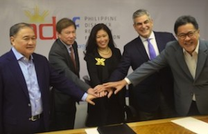 IBM Philippines chief Mariels Almeda Winhoffer (center) with PDRF officials (L-R) Manuel V. Pangilinan, Rene S. Meily (president of PDRF), Jaime Augusto Zobel de Ayala, and Guillermo Luz