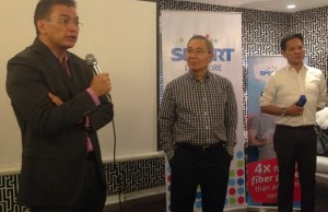 Smart head of the wireless consumer division Charles Lim (left) speaks as Smart public affairs head Ramon Isberto (center) and Smart technology group head Roland Pena listen during the press briefing in Makati City