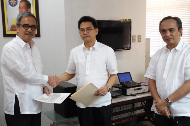 DOST-ASTI chief Denis Villorente (center) is congratulated by DOST sec. Mario Montejo after his oath-taking as deputy executive director for e-government at the ICT Office. At right is ICT head Louis Casambre