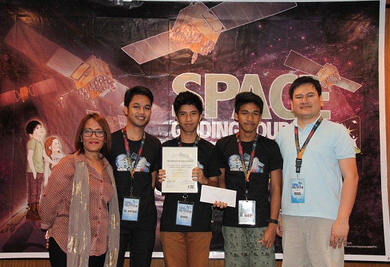 The winning team from the Palawan State University Laboratory High School. (From left to right) Ruby R. Cristobal, chief of science and technology manpower education, research and promotions division of DOST-SEI; McArthur Maravilla, coach, PSULBHS; Reniel Rosacena and Nur Alan Paylo Barte, students from PSULBHS; Rogel Mari Sese, Focal Person, Philippine Space Science Education Program