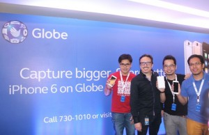 Globe chief operating advisor Peter Bithos (2nd from left) with the first owners of iPhone 6 in the country during the recent launch of Apple's flagship smartphone