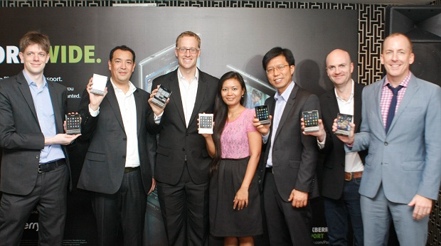 BlackBerry execs showing off the new BlackBerry Passport during the local launch held at Romulo Cafe in Makati City