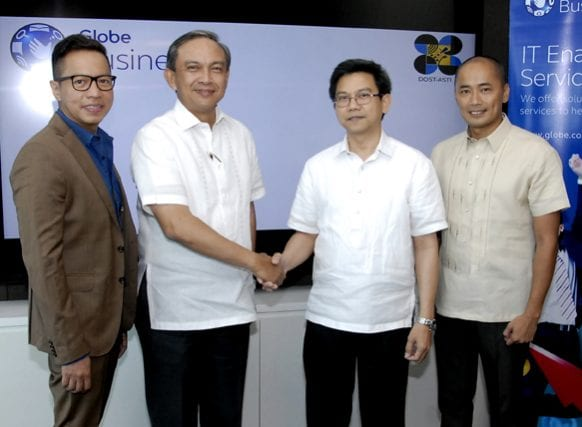 iGovPhil project director Denis Villorente (2nd from right) seals the agreement with Globe EVP and COO Gil Genio during a joint activity by Globe and the DOST-Advanced Sciences Technologies Institute, making official the co-location of government files and resources to the Globe data center. Also in the photo are (leftmost) Globe IG vice president Rey Lugtu and Globe Business cluster head Francis Neil Mendoza (rightmost)