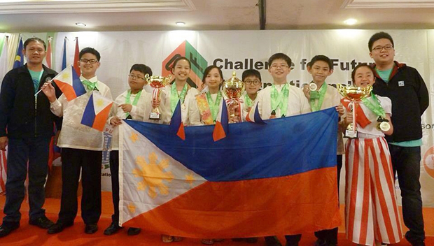 The Philippine team at the awarding ceremony of the 1st Challenge for Future Mathematicians 2014 in Bogor, Indonesia. They are (from left) team leader Elmer Apistar, Aiman Andrei Kue, Dominic Lawrence Bermudez, Maxinne Louise Dominique Co, Naomi Anne King, Immanuel Josiah Balete, Steven Reyes, Jose Lorenzo Abad, Vanessa Ryanne Julio and team leader Renard Eric Chua. Photo credit: MTG