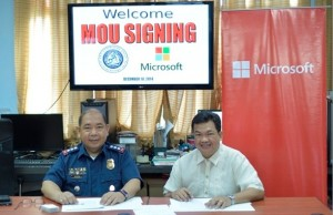 Photo shows Raul Cortez, director for corporate and legal affairs at Microsoft Philippines (right) and Gilbert Sosa, director of the PNP-Anti-Cybercrime Group