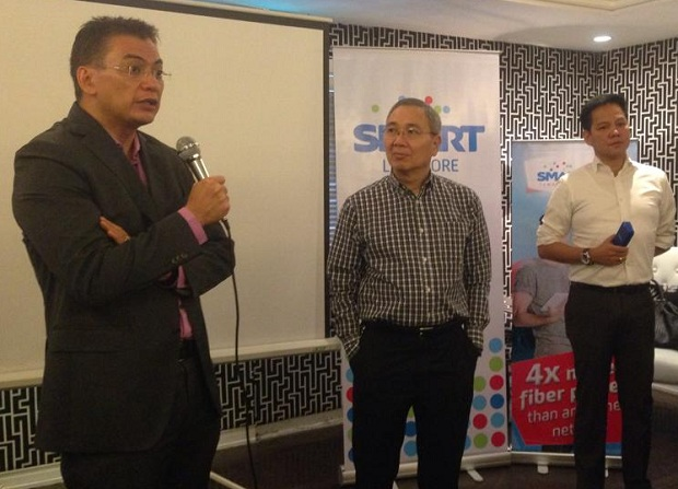 Charles Lim, EVP and wireless consumer division head at Smart and Sun (left) is seen in this file photo speaking during a press briefing. With him are fellow Smart execs Ramon Isberto and Roland Pena