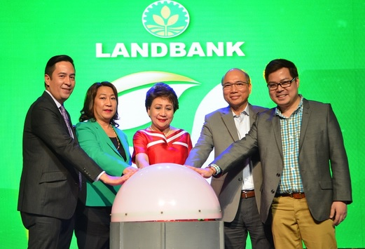 Smart chief wireless advisor Orlando B. Vea (2nd from right) and Landbank president and CEO Gilda E. Pico (center) led in tapping the ceremonial button signaling the official launch of the MLS to the bank's clients last August 8. Also in photo are, from left, Jovy Hernandez, FVP and head of PLDT Alpha Enterprise; Jocelyn Cabreza, EVP of Landbank; and Lito Villanueva, head of payments innovation, digital ecosystems and global engagements at SMI