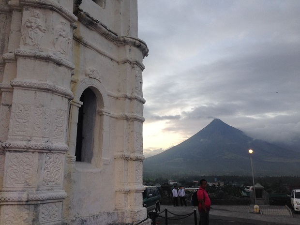 The belfry of baroque-style Daraga Church, which sits on a hill, is seen here with an arresting view of the Mayon Volcano