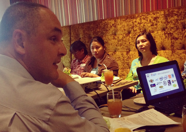 Intel PH chief Calum Chisholm (left, foreground) discussing the DigiBayanihan project in a media briefing as ICT Office deputy executive director Bettina Quimson (right) looks on