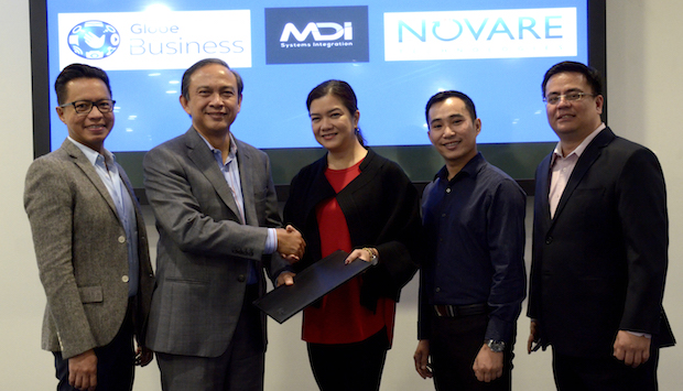 Photo shows (from left) Rey Lugtu, Globe VP for IT-enabled services, Globe chief strategy officer and chief Operating officer for business and international markets Gil Genio, Globe Business VP for sales Dion Asencio, MDI and Novare CEO Myla Villanueva, and MDI and Novare head for services delivery Rico Salgado