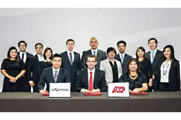 Signing the lease agreement between ADP and Aeon Centre developer Aeon Prime Land Development Corporation are ADP Vice President & General Manager Josep Maria Elias (seated, center), Aeon Prime Chief Operating Officer Charles Vincent Ong (seated, leftmost), and ADP Senior Finance Director Laura Baui (seated, rightmost). Witnessing the ceremony are (standing, L-R): Tetet Castro, Tenant Advisory Group Director, Cushman & Wakefield; Neil Ong, VP for Operations, AeonPrime; Mike Garcia, Senior Facilities Manager, ADP; Elaine Limoanco, Senior Business Solutions Manager, ADP; Dino Ouradnik, Senior Service Operations Director, ADP; Cris Mirador, Shared Services Director, ADP; Grace Mercado, Leasing Manager, AeonPrime; George Mathews, Interim Human Resources Director, ADP; Mai Magtoto, Senior Finance Manager, ADP; Joe Curran, General Manager, Cushman & Wakefield; and Margarita Escueta, Marketing & Communications Manager, ADP.