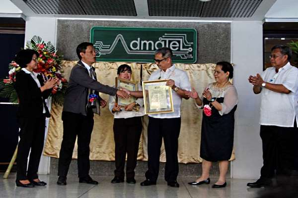 Secretary Montejo (4th from left) while receiving the Certificate of Accreditation from Dionisio, OIC of PAB, for the two labs of Admatel.  With him were Admatel project leader Dr. Basilia (3rd , L),  ITDI director Dr. Azanza (2nd,R), and Admatel program manager Virgilio Aguinaldo (R)