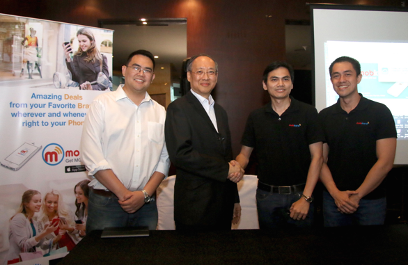 Photo shows (from left) IdeaSpace president Earl Martin Valencia, Globaltronics CEO William T. Guido, and TheKard co-founders Francis Uy and Carlo Calimon