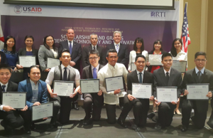 US Ambassador to the Philippines Philip S. Goldberg and USAID director of Office of Education Robert Burch stand among STRIDE scholarship awardees