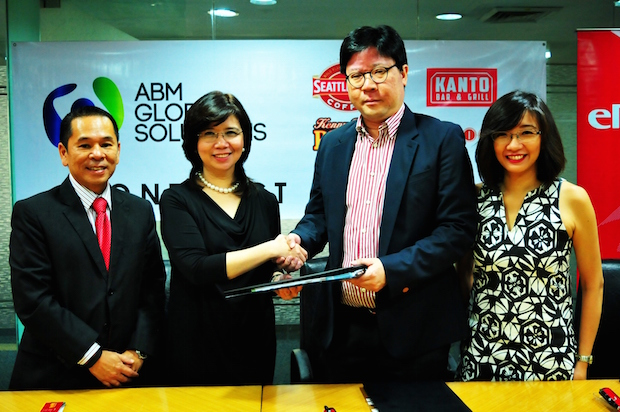 Nerissa S. Ramos, ePLDT Group COO and AGS president (2nd from left) and Frederick T. Siy, EPEI president,  seal the deal with a handshake. Also present during the event were Luis Ignacio A. Lopa, AGS general manager (extreme left) and Rea Enrica V. Cruz, EPEI general manager