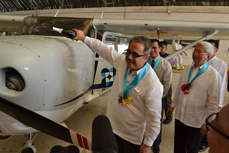 In this file photo, DOST sec. Mario G. Montejo (front) pours champagne moments before the LiDAR-equipped aircraft took off as UP President Alfredo E. Pascual (right) and UP Diliman Chancellor Caesar A. Saloma (middle) look on