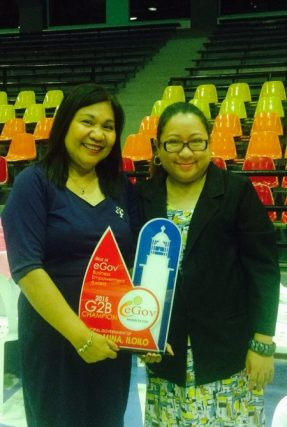 A representative of Mina, Iloilo (left) with eGov Awards chair Jocelle Batapa-Sigue