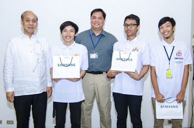 The triumphant PUP team with ICT Office cybersecurity consultant Drexx Laggui (center) and ICT Office official Raul Nilo (left)