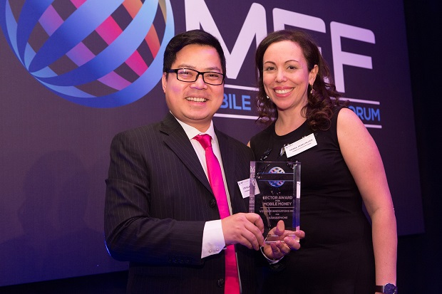 Lito Villanueva, vice president and head of financial innovations, digital inclusion and alliances at Voyager Innovations, receives the Best in Mobile Money Award from Rimma Perelmuter, CEO and global board director at the Mobile Ecosystem Forum during the Meffys Gala Dinner held in London