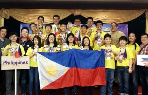 Filipino math wizards proudly display the Philippine flag and the medals they won together with their coaches at the awarding ceremony of the International Teenagers' Mathematical Olympiad 2015 in Malaysia