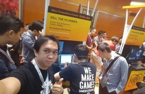 "Game developer Bari Silvestre (left) exhibiting ""Kill the Plumber"" in one of the gaming confabs abroad"