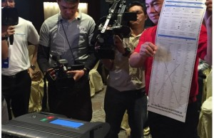 """Rep. Nicasio Aliping Jr. of the Joint Congressional Oversight Committee displays a spoiled ballot after he put an """"X"""" on it. Credit: Instagram page of Atty. Karen Jimeno"""