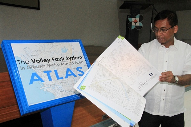 Phivolcs director Renato Solidum showing off the the Valley Fault System atlas