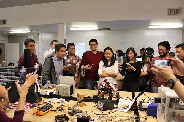 The participants observe some of the live demonstration of a prototype project at the Singularity University during one of their tours in Silicon Valley