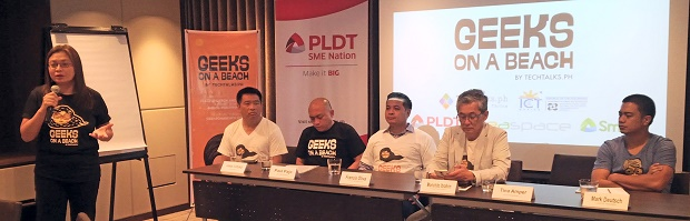 Photo shows Tina Amper, founder of TechTalks.ph (standing), explaining the idea behind GOAB. Also in the picture are (from left) Joey Limjap, vice president and head of PLDT ICT research and development; Paulo Pajo, developer evangelist at Smart; Francis Oliva, head of community partners at PLDT SME Nation; Monchito Ibrahim, deputy executive director of ICT Office; and Mark Deutsch, co-founder of Happy Garaje