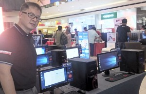 Jesse Tan, vice president for sales and marketing at PC Express, proudly shows off some of the units during the launch